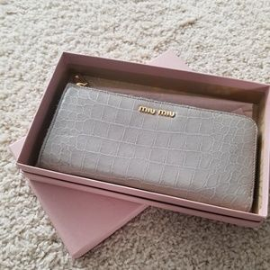 Miu Miu zip zip around long leather wallet